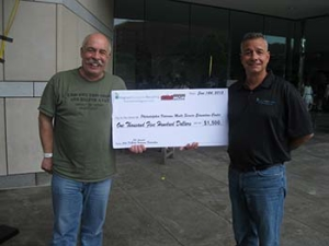 Magnum Computer Recycling owner John Martorano, Jr (right) gave a check to Philadelphia radio legend, John DeBella in support of local area veterans during WMGK's radio-thon June 14, 2013.